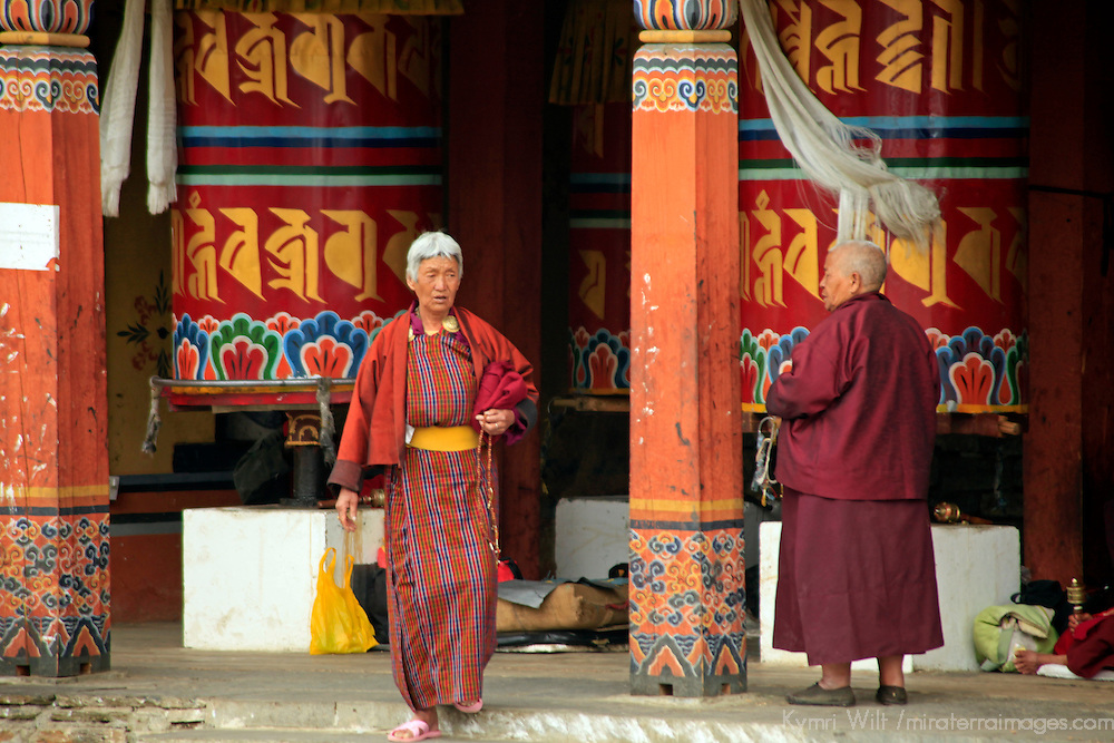 Asia, Bhutan, Thimpu. Women at the prayer wheels of the Memorial Chorten in Thimpu, Bhutan.
