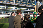 Ascot raceday, 21st November 2016. Racehorse owners with their jockeys in the parade ring before the race.