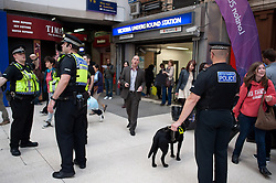 © licensed to London News Pictures. London, UK. 20/07/12. Police dogs outside the Victoria Underground entrance. Pictures show Victoria station yesterday where an increased police presence was visible in the run up to the London 2012 Olympic Games. Officers from the Metropolitan & British Transport Police conducted searches and patrols in conjunction with the Royal Military Police in the area. Photo credit: Jules Mattsson/LNP