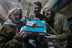© licensed to London News Pictures. London, UK 29/11/2012. Zombie lookalikes posing at the launch of Nintendo's latest gaming console, Wii U at HMV Store in Oxford Street, London. Photo credit: Tolga Akmen/LNP