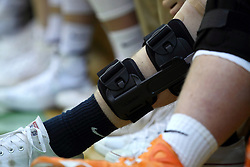 February 26, 2015:  knee brace on leg of a male basketball player