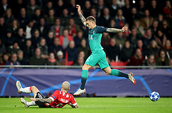 PSV Eindhoven's Angelino (left) and Tottenham Hotspur's Kieran Trippier (right) battle for the ball