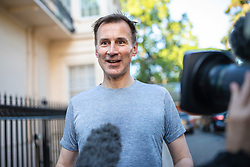 © Licensed to London News Pictures. 20/06/2019. London, UK. Foreign Secretary Jeremy Hunt speaks to the media after returning to his London home after a run. Photo credit: Rob Pinney/LNP