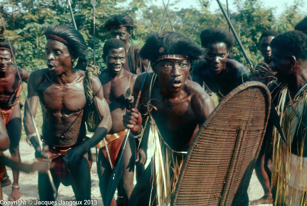 Festivities to celebrate the independence of the Congo, June 30, 1960 at Ikela in Central Congo. The Belgian Congo became the Republic of the Congo, later Zaire, and now Democratic Republic of the Congo. Men of Kela tribe pertaining to Mongo linguistic group dancing with spear and plaited shield.<br />