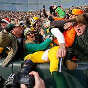 Aaron Rodgers Lambeau Leap during the first half of an NFL football game Saturday, Dec. 24, 2016, in Green Bay, Wis. (AP Photo/Matt Ludtke)