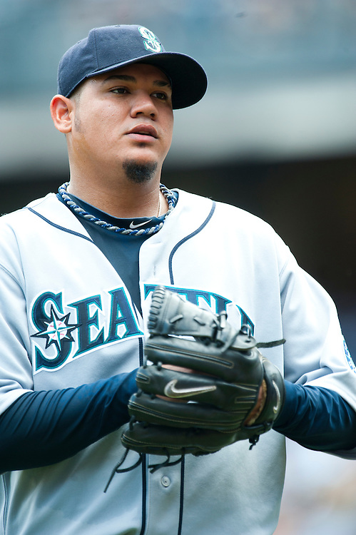 NEW YORK - JULY 27: Felix Hernandez #34 of the Seattle Mariners looks on during the game against the New York Yankees at Yankee Stadium on July 27, 2011 in the Bronx borough of Manhattan. (Photo by Rob Tringali) *** Local Caption *** Felix Hernandez
