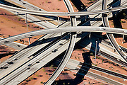 Massive highway interchanges connect urban centers and suburban ring roads.  Little to no public transportation exists, leaving exurban dwellers with no alternative to the car.