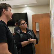OCTOBER 6, 2017--RINCON, PUERTO RICO ---<br /> Maria Isabel Torres, Associate Director of Costa Salud Hospital shoes Damon Taugher of  Direct Relief a map of areas serviced by her staff following the path of Hurricane Maria through Puerto Rico.<br /> (Photo by Angel Valentin/Freelance)