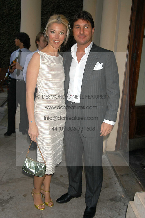 MISS TAMARA BECKWITH and MR GEORGE VERONI at the Tatler Summer Party in association with Moschino at Home House, 20 Portman Square, London W1 on 29th June 2005.<br />