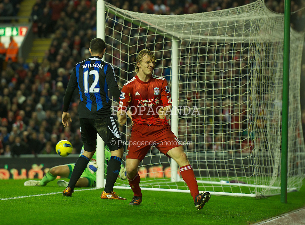 LIVERPOOL, ENGLAND - Saturday, January 14, 2012: Liverpool's Dirk Kuyt looks dejected after missing a chance against Stoke City during the Premiership match at Anfield. (Pic by David Rawcliffe/Propaganda)