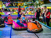 24 NOVEMBER 2018 - BANGKOK, THAILAND:  Children ride bumper cars on the midway at the Red Cross Fair. The Red Cross Fair is a fund raiser and annual event in Bangkok that draws thousands of attendees every night of its nine day run. The fair features games of chance, a midway with rides, handicrafts and food. This is the first year the fair has been in Lumpini Park. Previously it had been held in the Dusit section of Bangkok. The 2018 Fair marks 125 years of service for the Red Cross in Thailand.   PHOTO BY JACK KURTZ