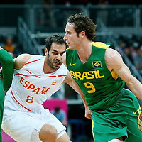 06 August 2012: Brazil Marcelinho Huertas drives past Jose Calderon during 88-82 Team Brazil victory over Team Spain, during the men's basketball preliminary, at the Basketball Arena, in London, Great Britain.