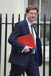 © Licensed to London News Pictures. 20/03/2013. Westminster, UK. Danny Alexander,  Liberal Democrat MP, Chief Secretary to the Treasury...Chancellor Of The Exchequer George Osborne poses for photographers whilst holding his red ministerial box outside 11 Downing Street In London, before presenting his annual budget to parliament today 20th March 2013. Photo credit : Stephen Simpson/LNP
