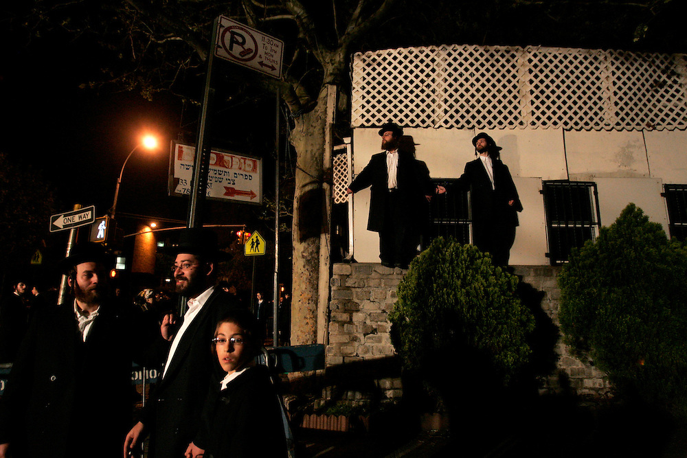 Mourners of the Grand Rabbi Moses Teitelbaum, worldwide spiritual leader of tens of thousands of members of the ultra-Orthodox Jewish sect, Satmar Hassidim, watch wait for his funeral procession in Brooklyn, New York after he died in New York City at the age of 91 Monday 24 April 2006.