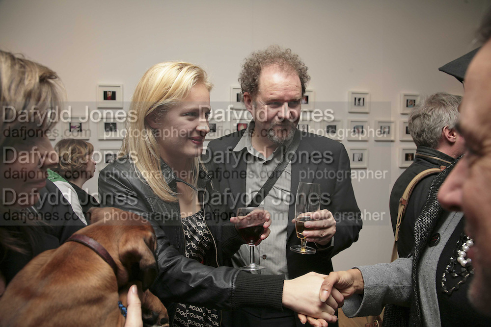 POLLY MORGAN AND MIKE FIGGIS, Exhibition of Polaroids by Rankin. The Gallery, 125 Charing Cross Road, London, WC2 7 December 2006. ONE TIME USE ONLY - DO NOT ARCHIVE  © Copyright Photograph by Dafydd Jones 248 CLAPHAM PARK RD. LONDON SW90PZ.  Tel 020 7733 0108 www.dafjones.com