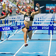 JONES/USTFF/2010 - Lolo Jones leaps across the finish line, winning the 100 meter hurdles in front of her home town crowd at the USTFF National Championships in Des Moines, Iowa.  photo by David Peterson