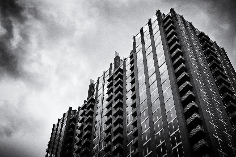 Looking up at a building of condominiums and clouds in Charlotte.