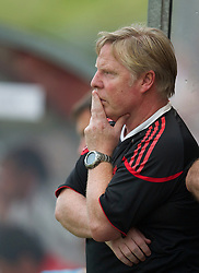 ZUG, SWITZERLAND - Wednesday, July 21, 2010: Liverpool's assistant manager Sammy Lee watches as his side take on Grasshopper Club Zurich during the Reds' first preseason match of the 2010/2011 season at the Herti Stadium. (Pic by David Rawcliffe/Propaganda)