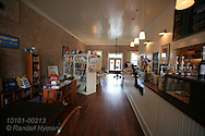 Cafe counter and bookshelves fill interior of Beehive Coffee and Books bookstore in author Harper Lee's hometown of Monroeville, Alabama.