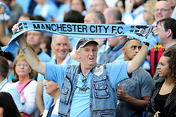 Manchester City fan - Photo mandatory by-line: Dougie Allward/JMP - Tel: Mobile: 07966 386802 22/09/2013 - SPORT - FOOTBALL - City of Manchester Stadium - Manchester - Manchester City V Manchester United - Barclays Premier League