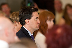 © Licensed to London News Pictures.02/04/2012. Birmingham, UK. Labour Party Leader Ed Miliband launched Labour's Local Election Campaign in Birmingham earlier today. Face in the crowd, Ed Miliband sits in amongst the audience. Photo credit : Dave Warren/LNP