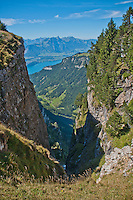 Looking down through a gorge at the Brienzersee from the Niederhorn in the Swiss Alps, Berner Oberland, Switzerland.