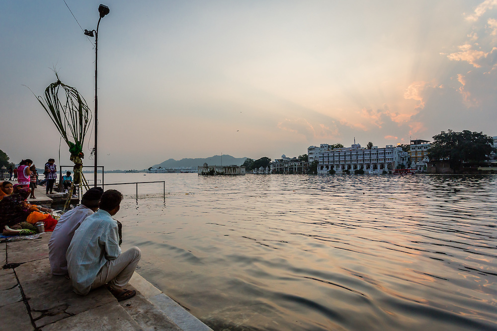 Some of the locals gather in the Lal Ghat area of Udaipur, in the shores of Lake Pichola, to witness the sunset.