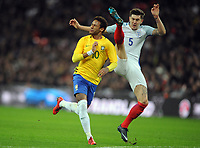 Football - 2017 / 2018 International Friendly - England vs. Brazil<br /> <br /> Neymar of Brazil  is challenged by a high kick from John Stones of England, at Wembley.<br /> <br /> COLORSPORT/ANDREW COWIE