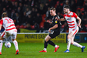 Mike-Steven Bahre of Barnsley (21) passes the ball during the EFL Sky Bet League 1 match between Doncaster Rovers and Barnsley at the Keepmoat Stadium, Doncaster, England on 15 March 2019.
