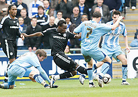 Photo: Steve Bond/Richard Lane Photography.<br />Coventry City v Chelsea. FA Cup 6th Round. 07/03/2009. Michael Essien (C) gets in a strong challange