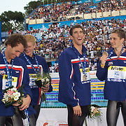 Michael Phelps of USA (centre) with team mates Aaron Peirsol, Eric Shanteau and David Walters as they circle the pool receiving their medals for winning gold in the Men's 4x 100m Medley relay at the World Swimming Championships in Rome, Italy on Sunday, August 2, 2009. Photo Tim Clayton..