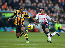 01.12.2013, KC Stadion, Hull, ENG, Premier League, Hull City Tigers vs FC Liverpool, 13. Runde, im Bild Liverpool's Raheem Sterling, action against Hull City's Maynor Figueroa // during the English Premier League 13th round match between Hull City Tigers vs Liverpool FC at the KC Stadion in Hull, Great Britain on 2013/12/01. EXPA Pictures © 2013, PhotoCredit: EXPA/ Propagandaphoto/ David Rawcliffe<br /> <br /> *****ATTENTION - OUT of ENG, GBR*****