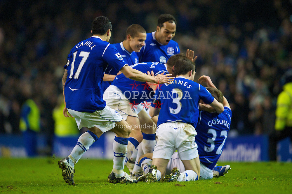 LIVERPOOL, ENGLAND - Wednesday, February 4, 2009: Everton's players celebrate Dan Gosling's extra time winning goal against Liverpool during the FA Cup 4th Round Replay match at Goodison Park. (Mandatory credit: David Rawcliffe/Propaganda)