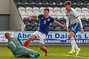 Scotland's Andrew Winter (Hamilton Academical) challenges Russian Keeper Aleksandr Alekseev (C) during the U17 European Championships match between Scotland and Russia at Simple Digital Arena, Paisley, Scotland on 23 March 2019.