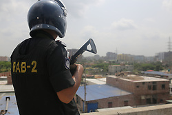 April 29, 2019 - Dhaka, Bangladesh - Law enforcer stands guard arround a suspected militant hideout at Bosila in Dhaka, Bangladesh on April 29, 2019. At least one people is killed in explosions at a suspected militant hideout in Dhaka, Rab official said. (Credit Image: © Rehman Asad/NurPhoto via ZUMA Press)