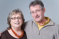 Portrait of a middle aged couple smiling,