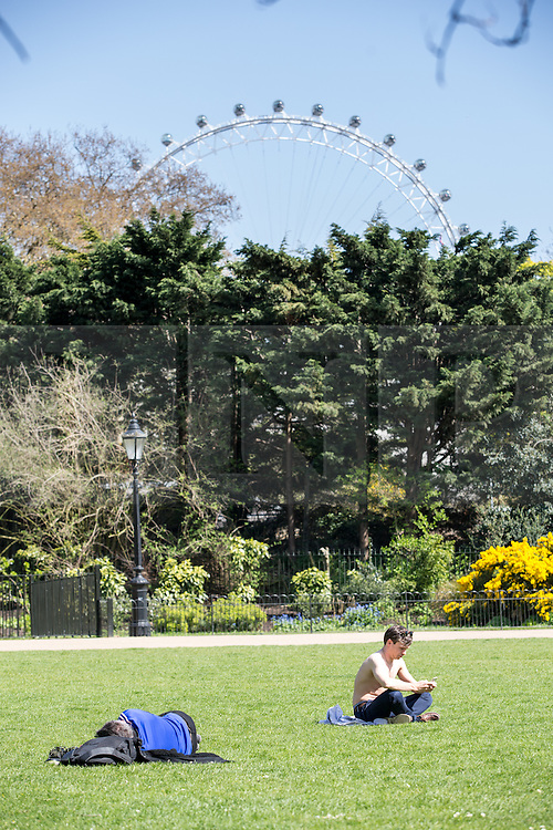 © Licensed to London News Pictures. 20/04/2016. London, UK. People sunbathing during warm weather in St James' park, central London. The MET Office predict highs of 13 degrees celsius. Photo credit : Tom Nicholson/LNP