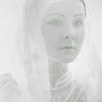 beautiful young caucasian woman looking aside in retro style