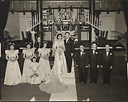 Japanese-American bride and groom with their wedding party, Los Angeles, CA.<br />