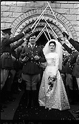 08/02/1964<br /> 02/08/1964<br /> 08 February 1964<br /> Wedding of Lieutenant Gerard Wright of McKee Barracks Dublin, son of Mr and Mrs Michael Wright of Tipperary and Miss Maeve Edge, daughter of Mr and Mrs Robert Edge, 29 Hillsbrook Grove, Whitehall Road, Terenure, Dublin at the Church of St. Agnes, Crumlin. The Bride and Groom leaving the church under the swords of the guard of honour made up of army officers.