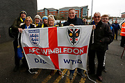 Wimbledon fans during the EFL Sky Bet League 1 match between Bolton Wanderers and AFC Wimbledon at the University of  Bolton Stadium, Bolton, England on 7 December 2019.