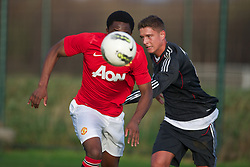 MANCHESTER, ENGLAND - Friday, November 25, 2011: Manchester United's Charni Ekangamene in action against Liverpool during the FA Premier League Academy match at the Carrington Training Ground. (Pic by David Rawcliffe/Propaganda)