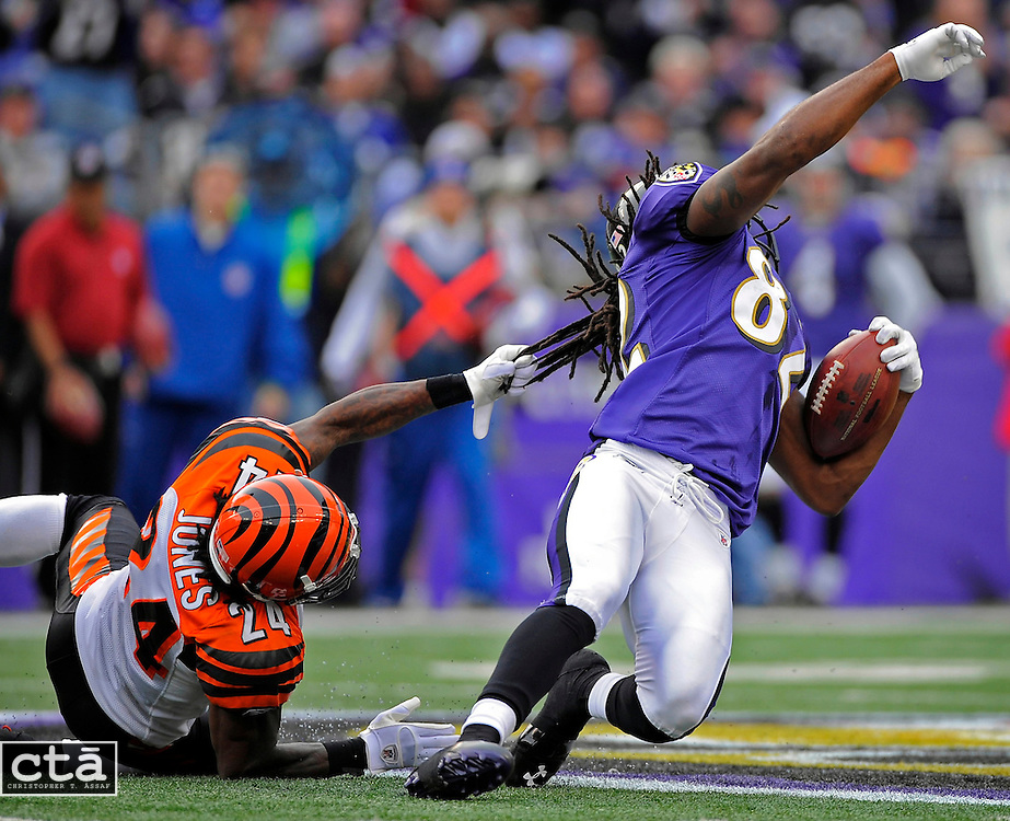 Bengals cornerback Adam Jones (24) grabs Ravens wide receiver Torrey Smith (82) by his hair at the Bengals 41. Smith gained 28 yards on the Joe Flacco pass, but no penalty was called for the hair-pulling incident. Baltimore beat the Bengals 31-24  at M&T Bank Stadium.