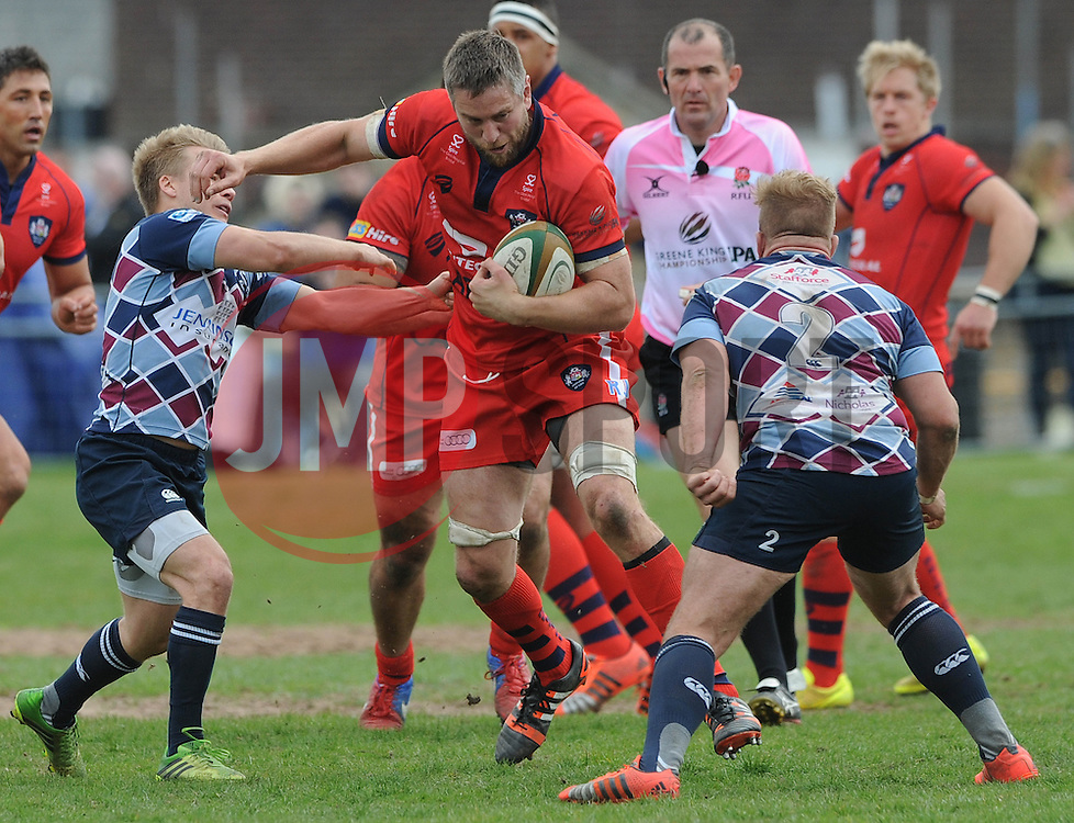 Bristol Rugby Number 8 Ryan Jones avoids a challenge from Rotherham Titans Scrum-Half Andy Davies - Photo mandatory by-line: Dougie Allward/JMP - Mobile: 07966 386802 - 10/05/2015 - SPORT - Rugby - Sheffield - Abbeydale Dale Sports - Rotherham Titans v Bristol Rugby - Greene King IPA Championship