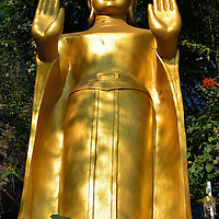 Buddha with Extended Palms on Mount Phousi in Luang Prabang, Laos  <br />
