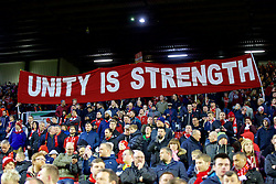 "LIVERPOOL, ENGLAND - Thursday, March 10, 2016: Liverpool supporters banner ""Unit Is Strength"" on the Spion Kop before the UEFA Europa League Round of 16 1st Leg match against Manchester United at Anfield. (Pic by David Rawcliffe/Propaganda)"