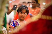 10 AUGUST 2012 - PHOENIX, AZ: A girl dressed as Rhada prays at a shrine during the celebration of Janmashtami at Ekta Mandir, a Hindu temple in central Phoenix. In the Hindu religion, Rhada is the friend of lover of Krishna. Janmashtami is the Hindu holy day that celebrates the birth of Lord Krishna. Hindu communities around the world celebrate the holy day. In Arizona, most of the Hindu temples in the Phoenix area have special celebrations of the day. PHOTO BY JACK KURTZ