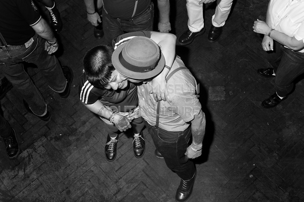 Unknown skinhead couple dance together, Brighton, 2014.