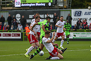 Accrington Stanley's Jordan Thorniley(12) tackles Forest Green Rovers Omar Bugiel(11) during the EFL Sky Bet League 2 match between Forest Green Rovers and Accrington Stanley at the New Lawn, Forest Green, United Kingdom on 30 September 2017. Photo by Shane Healey.