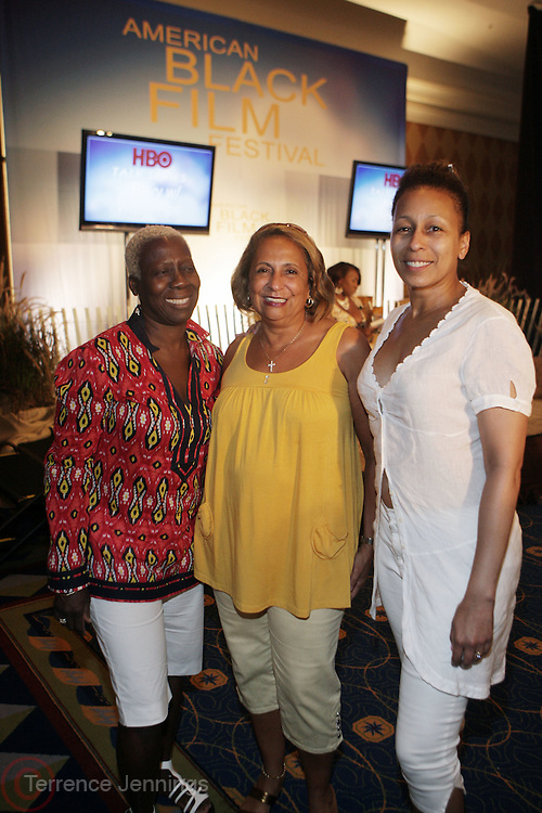 l to r: Olivia Smashum, Cathy Hughes and Tamara Tunie at The HBO Talk Series with Vivica Fox during the The 2009 American Black Film Festival held at The Ritz-Carlton in Miami Beach on June 27, 2009 ..